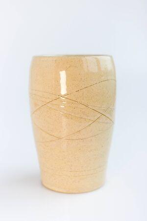 beige vase on a white background. minimalism style. interior decoration