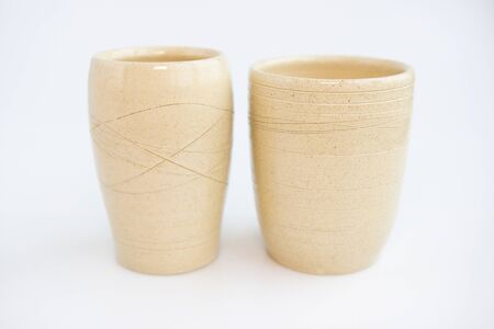 two beige vases on a white background. minimalism style. interior decoration Stok Fotoğraf