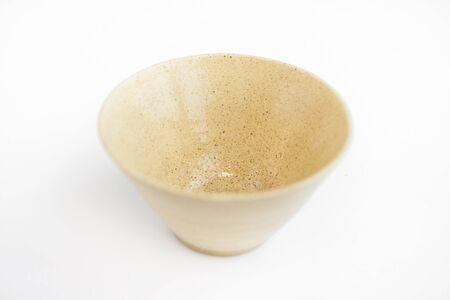 beige clay plate on a white background. minimalism style. handwork