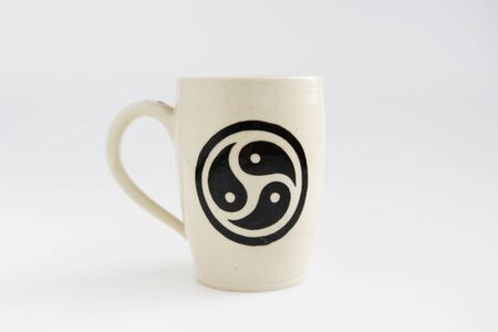 white clay mug with trixel - a symbol of bdsm.