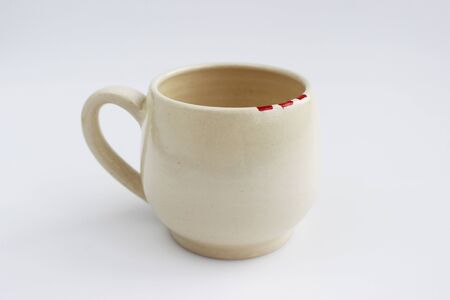 ceramic mug with red spots painted with overglaze paint. handmade