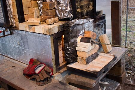 wood firing of ceramic products in a homemade stove. beginning - heating the furnace with a gas burner to remove excess moisture.