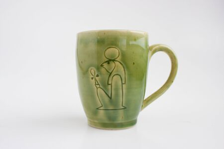 mug with the image of the god Ra. Author's ceramics. Color Celadon. egyptian symbolism