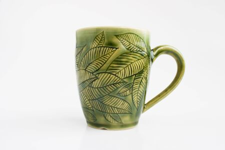 mug with leaves. author's decor. forest design Standard-Bild - 142795518