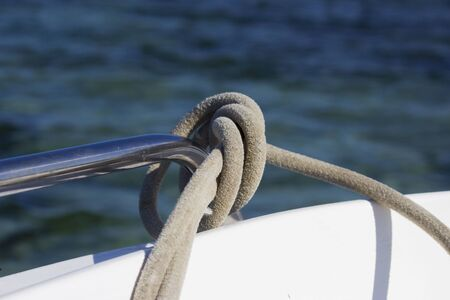 mooring rope tied by a sea knot on the railing of the boat. reportage shooting