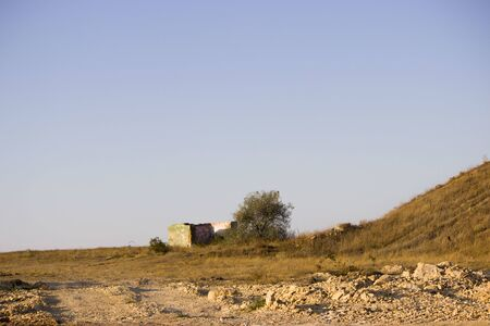 Steppe landscape with house and tree at the road construction repairs.