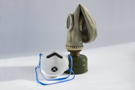 respirator and old gas mask. concept of peace and war. a means of protection against chemical and virological weapons.
