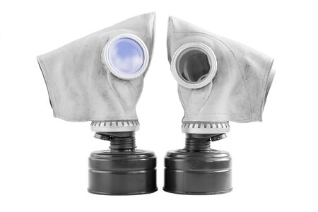 two old soviet gas masks on a white background. concept of peace and war. a means of protection against chemical and virological weapons. Isolated Banque d'images