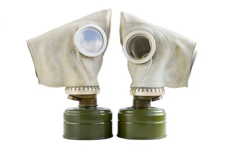 two old soviet gas masks on a white background. concept of peace and war. a means of protection against chemical and virological weapons. Isolated Standard-Bild