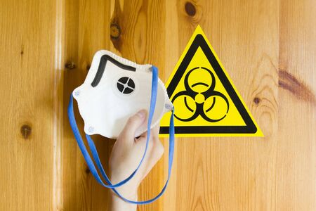 sign of biological danger and biological weapons for warning inscriptions and respirator for protection against virus, dust and gases. danger of the covid19 virus.
