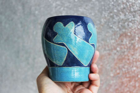 handmade ceramic vase. clay covered with engob, glaze and passed two firing.