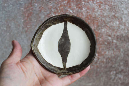ceramic plate Dragons Eye. Technique of Nerikomi and Neryage. Two types of clay of different color, transparent glaze and two firing