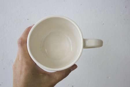 white clay mug. Handmade. covered with transparent glaze, two firing Standard-Bild