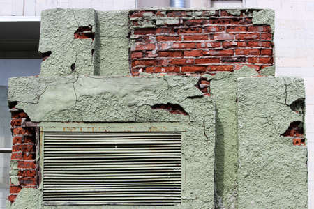 peeling green plaster on a brick transformer box. background for the image of devastation and mismanagement. Russia