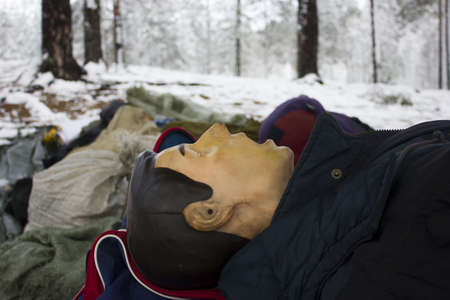 first aid. Dummy of a person on which to train to provide first aid. Reportage from a place in the winter forest where the exercises are taking place