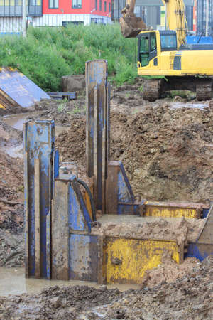 metal structural immediate support and pump that pumps the water to drain areas on the stretch of road construction Standard-Bild