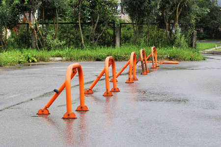 orange parking barriers, parking space limiters and blockers. Parking and road equipment