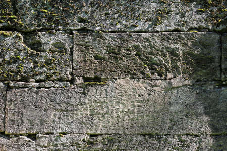 background from ancient stone. ancient wall that separates two parts of the park from each other. Eighteenth century. Stone and history Standard-Bild