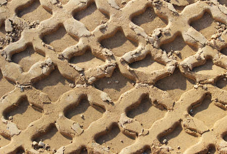 relief traces of heavy construction equipment in the sand. beautiful texture close-up. Standard-Bild