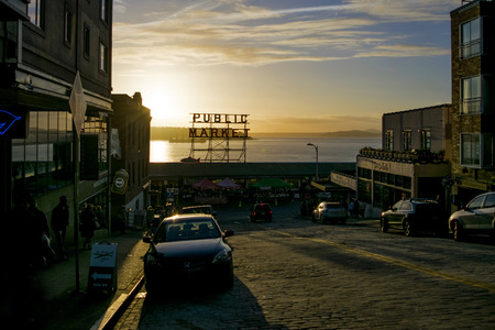 pike place market sign: The Public Market in Seattle at Sunset