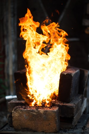 Flaming fire in the handmade forge Stock Photo