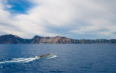 Crater lake Oregon, offers boat rides around the rim photo