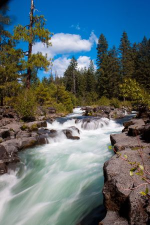 Rogue river in Oregon filtering trough the lava tubes photo