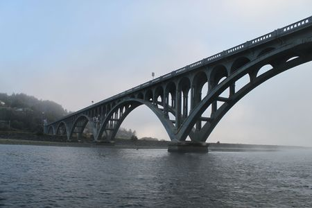 Foggy view of the bridge from the river