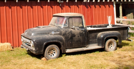 vintage truck: old pickup truck parked by a barn in Idaho Stock Photo