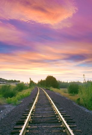 wood railroad: pretty afternoon in North Idaho over the trin tracks