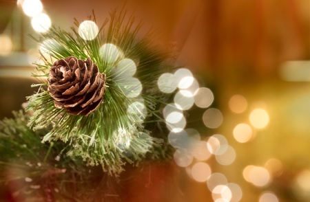 fale: decorative pine cone, a fake oune tieh some fake needles as a table top centerpiece decoration Stock Photo