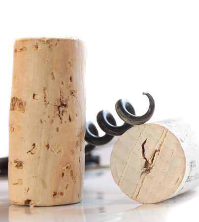 closeup of wine corks with an opener