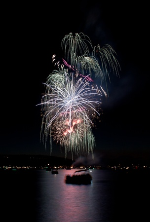 forth: Beautiful white explosion of fireworks in idaho for july forth Stock Photo
