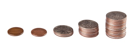 coins stacked from small to larger amounts isolated on  a white background