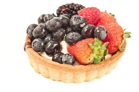 prety: fruit tart closeup with blueberries, raspberries and strawberries isolated on white