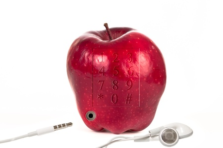 golden delicious red fruit with earphones and plugin for better listening photo