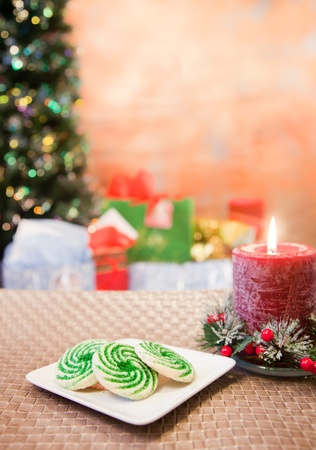 Christmas cookies on a table with blured tree and gifts Stock Photo - 11788702