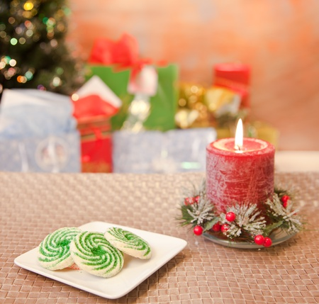 Christmas cookies on a table with blured tree and gifts Stock Photo - 11788693