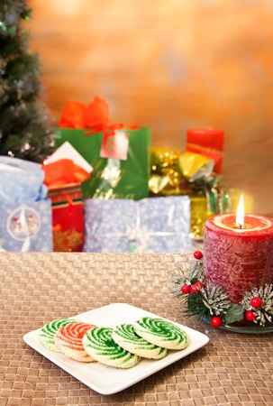 Christmas cookies on a table with blured tree and gifts photo