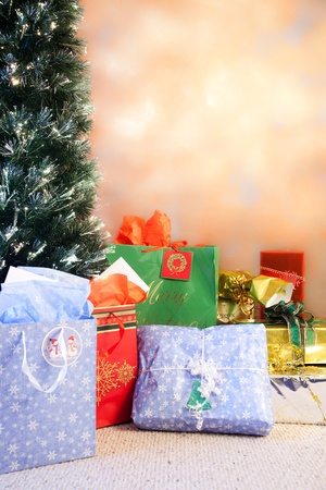 gifts and christmas tree background set up traditionally Stock Photo - 11788725