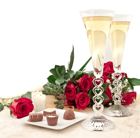 perfect valentines day surprise with chocolates, roses and champagne with hart stem glass photo