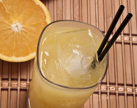 alcohol screwdriver: fresh oranges and a glass filled with juice and vodka Stock Photo