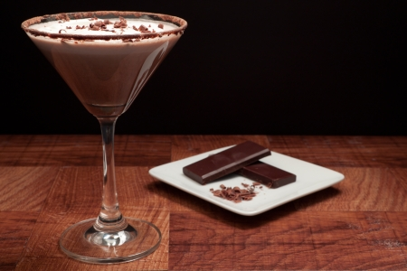 chocolate martini garnished with chocolate power rim and chocolate shavings on cream photo