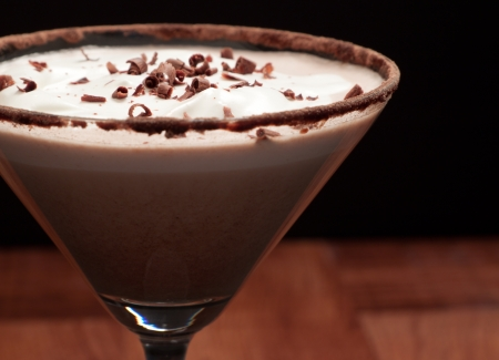 chocolate martini garnished with chocolate power rim and chocolate shavings on cream Stock Photo
