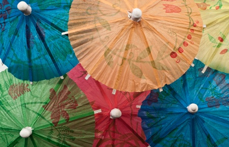 macro of multiple drink parasols wide open displaying different colors photo