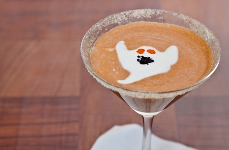 pumpkin martini decorated with gram cracker and a ghost made with cream float photo