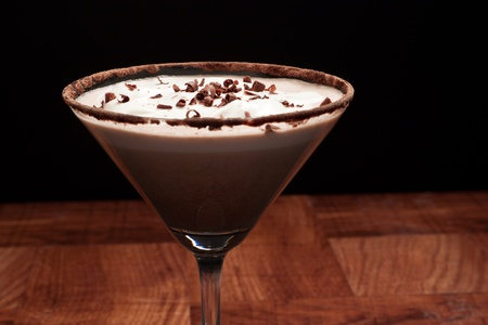chocolate martini garnished with chocolate power rim and chocolate shavings on cream Stock Photo