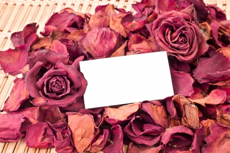dried roses as a background with card for text in the middle Stock Photo - 12102131