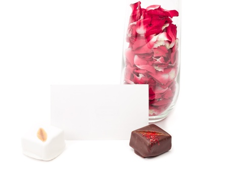 isolated rose petals in a champagne flute with a blank text card photo