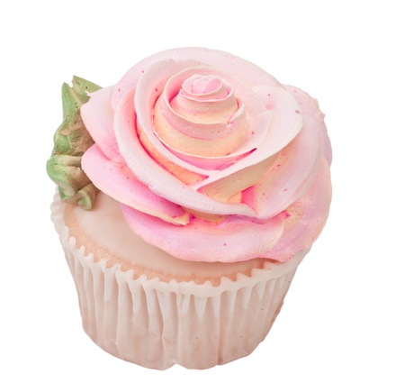 isolated cupcake shape like a rose on a white background with a green leaf photo